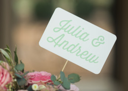 skewer signs in floral arrangements for wedding